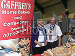 John Caffrey Chairperson of the Ardee Traders Association and Dyna Donegan from Caffrey's Home Bakery and Coffee Shop pictured at the Enterprise day in Ardee parish centre. Photo:Colin Bell/pressphotos.ie