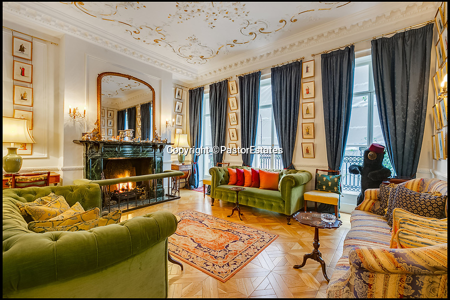 BNPS.co.uk (01202 558833)Pic: PastorEstates/BNPS<br /> <br /> A Georgian townhouse in Mayfair that was a hangout for the Beatles before they split up is on the market for £9m.<br /> <br /> The Grade II listed house in Charles Street was owned in the late 1960s by Apple Corps, the Beatles' music company, and the Fab Four are known to have spent time at the London house.<br /> <br /> John Lennon painted graffiti on some kitchen tiles and the band posed for a photo in a bath that stood in the middle of the sitting room in the adjoining mews house.<br /> <br /> Sadly the signs of the famous foursome's occupation have long since gone and the new owner will not get some Lennon artwork as the kitchen tiles were sold at auction more than a decade ago.<br /> <br /> But the terraced house - on the market with Pastor Estates - is now a comfortable and colourful family home.