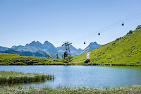 Germany, Bavaria, Upper Allgaeu, Oberstdorf: Schlappold Lake underneath Fellhorn cable car station Schlappoldsee, at background the Allgaeu Alps | Deutschland, Bayern, Oberallgaeu, oberhalb Oberstdorf: der Schlappoldsee unterhalb der Fellhornbahn Station Schlappoldsee vor den Allgaeuer Alpen