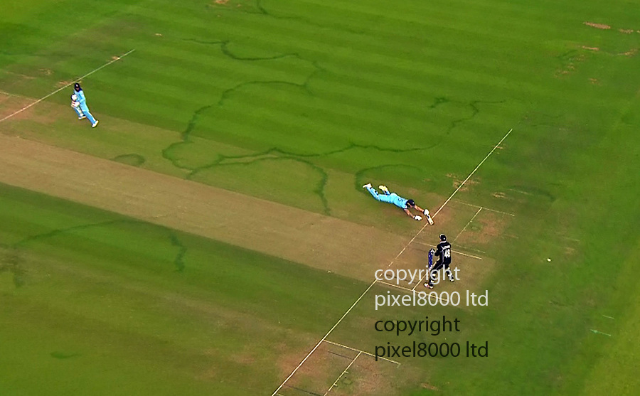 Pic shows: Eng v NZ Cricket final<br /> <br /> Ben Stokes whacks it out to mid-wicket, he comes back for two as the ball is thrown in.<br /> <br /> The ball HITS HIS BAT AND RUNS AWAY FOR FOUR.<br /> <br /> THAT IS SIX RUNS.<br /> <br /> <br /> <br /> <br /> supplied by Pixel8000 Ltd