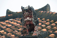 The shiva (lion-dog) statues were first brought to Okinawa from China in the 14th century. These figures are believed to ward off evil spirits and were originally used as guardians to residences and shrines.
