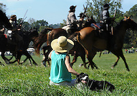 NWA Democrat-Gazette/ANDY SHUPE<br /> Carol Aiken of Springfield, Mo., watches Saturday, Sept. 26, 2015, alongside her husband's dog, Jay, as members of the Confederate cavalry ride past during a re-enactment of the Civil War Battle of Pea Ridge in Pea Ridge. Visit nwadg.com/photos to see more photos from the weekend.