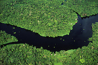 Brazil, Para, aerial view of river with dwellings in Tropical Rain Forest on Marajo Island in Amazon estuary.