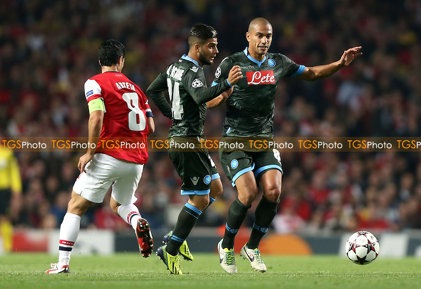 Lorenzo Insigne and Gokhan Inler of Napoli - Arsenal vs Napoli, Champions League Group F game at the Emirates Stadium, Arsenal - 01/10/13 - MANDATORY CREDIT: Rob Newell/TGSPHOTO - Self billing applies where appropriate - 0845 094 6026 - contact@tgsphoto.co.uk - NO UNPAID USE