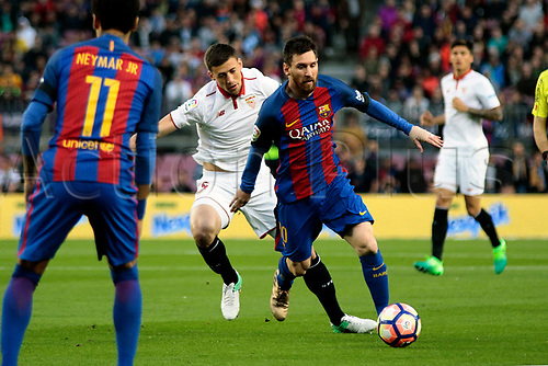 April 5th 2017, Nou Camp, Barcelona, Spain, Spanish La Liga football, FC Barcelona versus Espanyol; Messi is challenged from behind by Lenglet of Espanyol