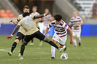 Houston, TX - Friday December 11, 2016: Ema Twumasi (22) of the Wake Forest Demon Deacons attempts to strip the ball from Amir Bashti (11) of the Stanford Cardinal at the NCAA Men's Soccer Finals at BBVA Compass Stadium in Houston Texas.