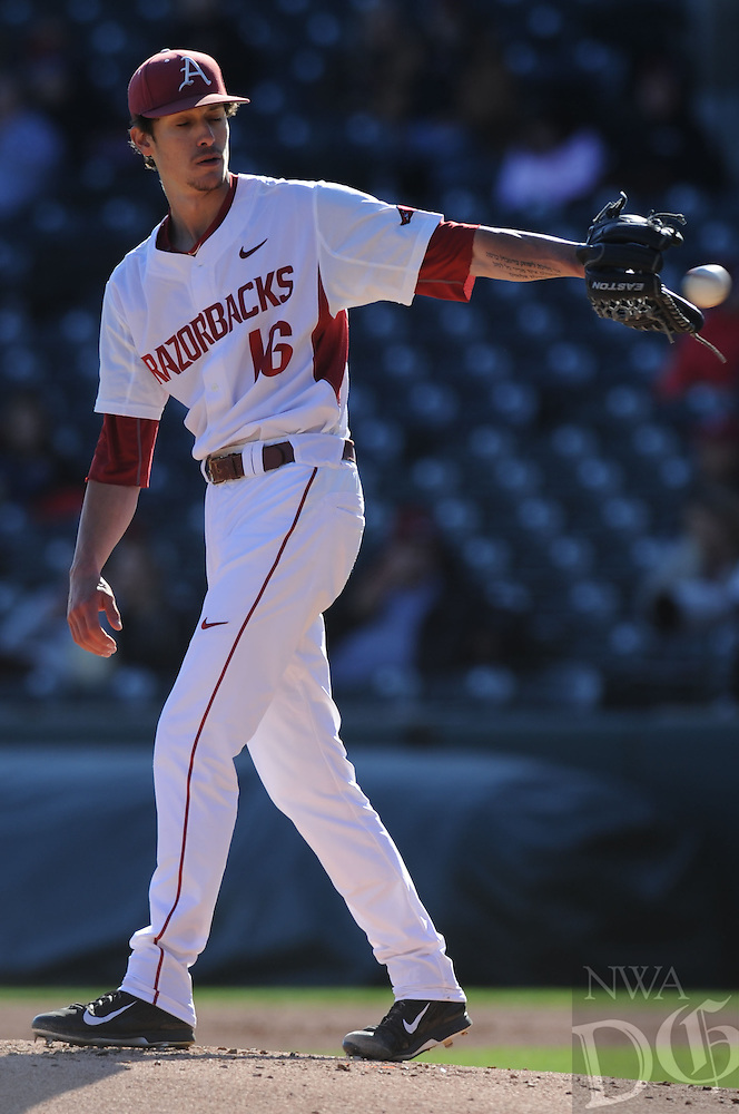 NWA Democrat-Gazette/ANDY SHUPE<br /> Arkansas starter Blaine Knight receives the ball from the plate against Bryant Friday, Feb. 24, 2017, during the second inning at Baum Stadium in Fayetteville. Visit nwadg.com/photos to see more photographs from the game.