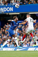 Tammy Abraham of Chelsea and John Egan of Sheffield United compete for a ball during the Premier League match between Chelsea and Sheff United at Stamford Bridge, London, England on 31 August 2019. Photo by Carlton Myrie / PRiME Media Images.