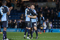 Matt Bloomfield of Wycombe Wanderers embraces Joe Jacobson of Wycombe Wanderers during the Sky Bet League 2 match between Wycombe Wanderers and Oxford United at Adams Park, High Wycombe, England on 19 December 2015. Photo by Andy Rowland.