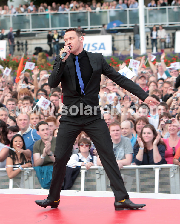 **ALL ROUND PICTURES FROM SOLARPIX.COM**.**NO UK NEWSPAPER PUBLICATION **UK MAGAZINE & SUPPLEMENT PUBLICATION ONLY** AND NO PUBLICATION IN FRANCE, SCANDINAVIA, AUSTRALIA AND GERMANY** .The official hand over for  the 2012 Olympic games took place by Buckingham Palace in central London..This pic:Will Young at the ceremony..JOB REF:7113-SFE       DATE:24_08_08 .**MUST CREDIT SOLARPIX.COM OR DOUBLE FEE WILL BE CHARGED* *UNDER NO CIRCUMSTANCES IS THIS IMAGE TO BE REPRODUCED FOR ANY ONLINE EDITION WITHOUT PRIOR PERMISSION*