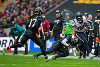 3rd November 2019; Wembley Stadium, London, England; National Football League, Houston Texans versus Jacksonville Jaguars; Tight End Jordan Akins of Houston Texans is tackled - Editorial Use
