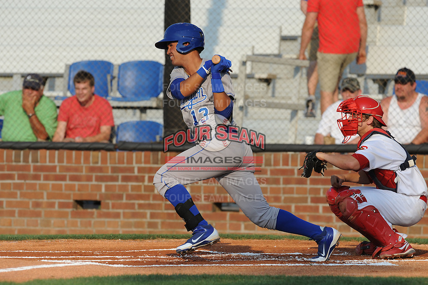 Burlington Royals shortstop Humberto Arteaga #13 swings at a pitch during a game against the Johnson City Cardinals at Howard Johnson Field on June 28, 2012 in Johnson City, Tennessee. The Royals defeated the Cardinals 14-2. (Tony Farlow/Four Seam Images).
