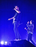 10 February 2017 - Hamilton, Ontario, Canada.  Max Kerman (vocals) and Mike DeAngelis (guitar) of Canadian rock band Arkells perform on stage during their homecoming concert to celebrate the release of 'Morning Report' at FirstOntario Centre.  Photo Credit: Brent Perniac/AdMedia