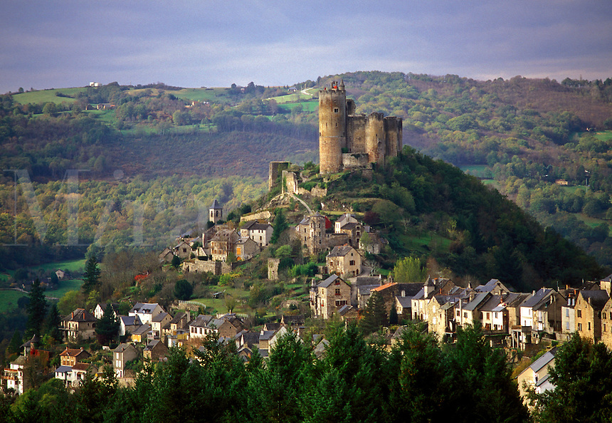 the Dordogne, France, Quercy, Midi-Pyrenees, Najac, Aveyron, Europe, A castle sits on top of the scenic medieval hilltop village of Najac.