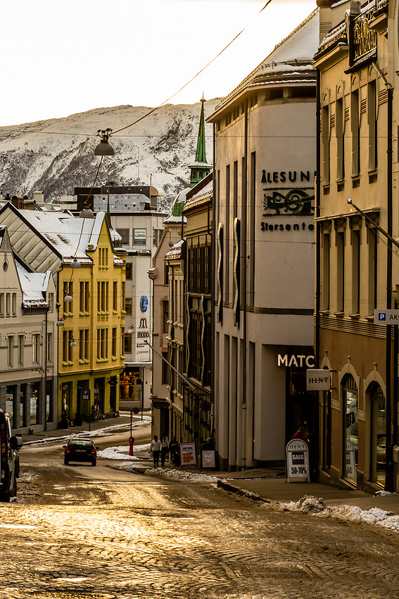 Alesund, Norway. The town is famous for its art nouveau (Jugendstil) architecture. The  town was rebuilt after a fire in 1904. Alesund is in the heart of Fjord Country, at the entrance to Geirangerfjord on Norway's west coast.