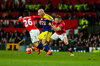 Sunday 05 January 2014<br /> Pictured: Jonjo Shelvey in the thickof it<br /> Re: Manchester Utd FC v Swansea City FA cup third round match at Old Trafford, Manchester