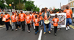 Participants walk in the Wear Orange Day March against gun violence on North Grand Boulevard on Saturday June 2, 2018. At center is St. Louis Mayor Lyda Krewson. June is National Gun Violence Awareness Month.<br /> Photo by Tim Vizer
