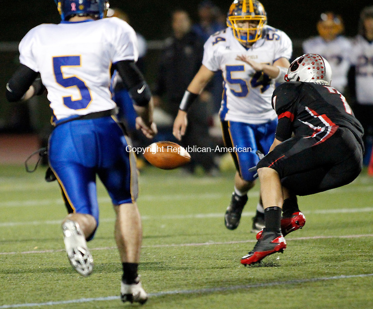 Southbury, CT- 05, November 2010-110510CM05  Pomperaug's Garrett DeLotto dives and makes a catch as, Brookfield's Nick Paez (#5) and Joey Acquanita (#54) move for the tackle Friday night in Southbury.  The pass was incomplete, as DeLotto was ruled down before he had possession. Christopher Massa Republican-American