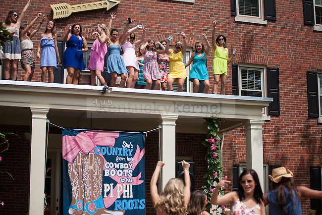 Women of the Pi Beta Phi sorority dance while they wait for their new members during UK's sorority bid day in Lexington, Ky., on Friday, August 22, 2014. Photo by Adam Pennavaria | Staff
