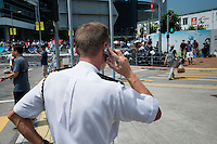 Hong Kong, Government Offices, 28 September 2014<br /> <br /> There are still some originally British policemen in the present Hong Kong police force. This one was using his phone with a Union Jack cover while organising the forces against the Occupy Central demonstrators.<br /> <br /> Photo Kees Metselaar