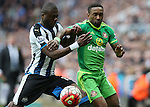 Sunderland's Jermain Defoe, right, vies for the ball with Newcastle United's Chancel MBemba, left, during the Barclays Premier League match at St James' Park Stadium. Photo credit should read: Scott Heppell/Sportimage