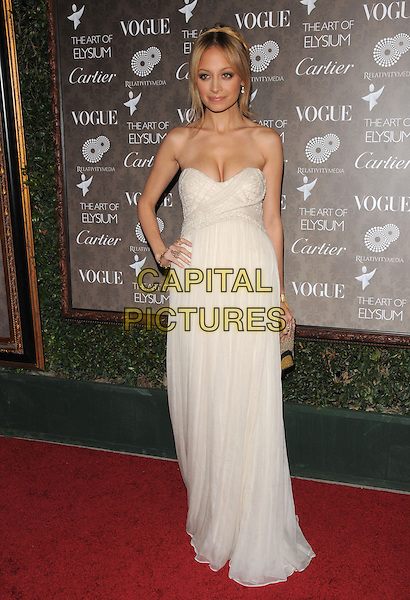 "NICOLE RICHIE .at The 2nd Annual Art of Elysium Black Tie Charity Gala ""Heaven"" held at The Vibiana in Los Angeles, California, USA,  January 10th 2009.                                                                     .full length strapless white dress clutch bag long maxi gold bracelet cleavage cream hand on hip.CAP/DVS.©Debbie VanStory/Capital Pictures"