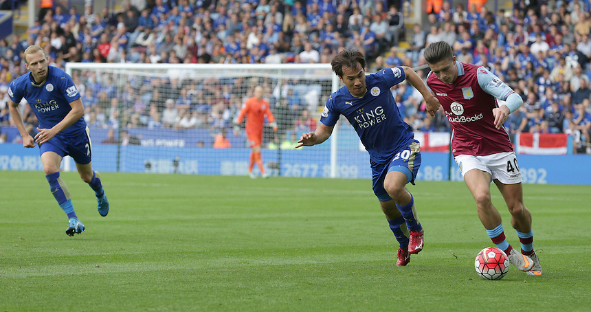 Leicester City's Shinji Okazaki and Aston Villa's Jack Grealish<br /> <br /> Photographer Stephen White/CameraSport<br /> <br /> Football - Barclays Premiership - Leicester City v Aston Villa - Sunday 13th September 2015 - King Power Stadium - Leicester<br /> <br /> &copy; CameraSport - 43 Linden Ave. Countesthorpe. Leicester. England. LE8 5PG - Tel: +44 (0) 116 277 4147 - admin@camerasport.com - www.camerasport.com
