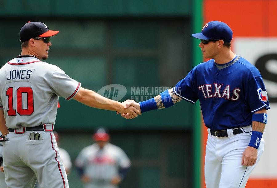 Jun. 19, 2008; Arlington, TX, USA; Atlanta Braves third baseman (10) Chipper Jones shakes hands with Texas Rangers right fielder Josh Hamilton prior to the game at the Rangers Ballpark. Mandatory Credit: Mark J. Rebilas-