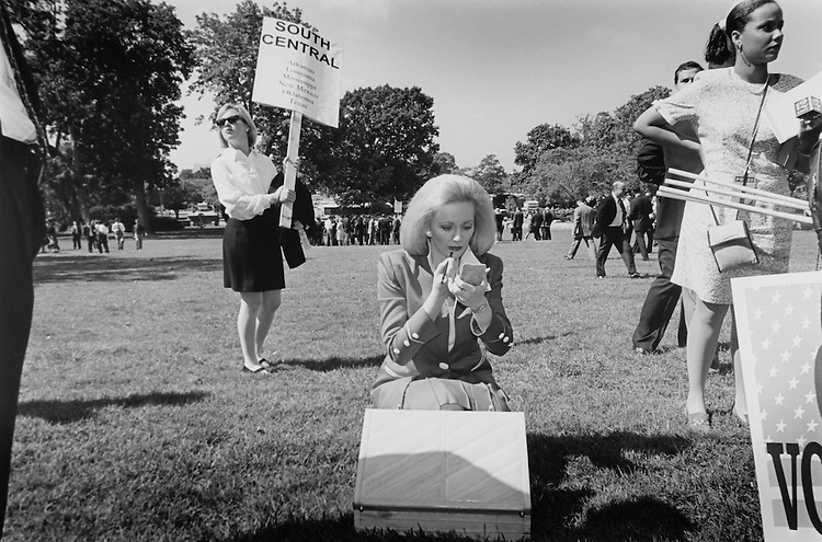 Needing a freshening up after signing Contract with America, Donna Peterson, R-Texas, applies a little lip liner. Several candidates gathered on lawn for interviews etc. after the main event. September 26, 1994 (Photo by Maureen Keating/CQ Roll Call)