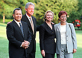 Washington, DC - July 15, 1999 -- Baraks and Clintons stopped and posed for a group photo as they walked to Marine 1 en route to Camp David, MD on 15 July, 1999.   From left to right: Prime Minister Ehud Barak of Israel, United States President Bill Clinton, U.S. First Lady Hillary Rodham Clinton, and Mrs. Ehud (Nava) Barak..Credit: Ron Sachs / CNP