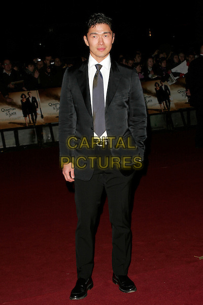 "RICK YUNE .The Royal World Premiere of ""Quantum Of Solace"" at the Odeon Leicester Square, London, England..October 29th 2008.James Bond full length black suit hand in pocket .CAP/AH.©Adam Houghton/Capital Pictures."
