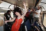 COACHELLA EXPRESS,CA - APRIL 24,2008: Kestrin Pantera dancing to a live DJ aboard a special Amtrak charter, the Coachella Express, someplace between Los Angeles and Indio, April 24,2008. The free train service is providing transportation to Coachella Valley Music & Arts Festival campers from Los Angeles' Union Station to the Empire Polo Fields and back. The Festival begins Friday, 125-acts will perform over the weekend.