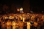 Palestinian Muslims perfom praying Taraweeh in al Aqsa mosque in the old city of Jerusalem after breaking the fast on the First day of the Moslem holy month of Ramadan on July 10, 2013. Photo by Saeed Qaq