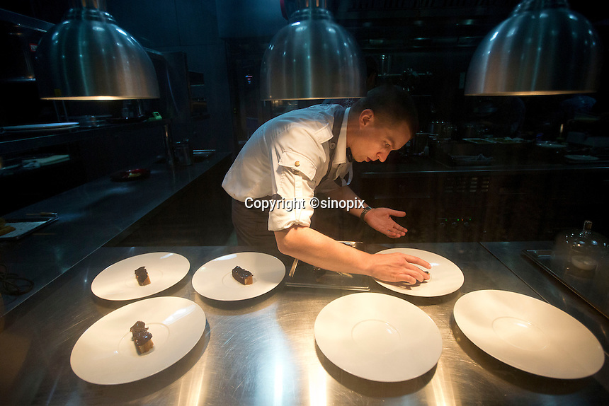 Kitchen work at the Ultraviolet restaurant in Shanghai, China on 27th Sept 2013.  The restaurant in run by Chef Paul Pairet. <br /> <br /> Photo by Qilai Shen / Sinopix