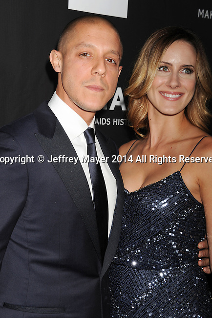 HOLLYWOOD, CA- OCTOBER 29: Actor Theo Rossi (L) and Meghan McDermott attend amfAR LA Inspiration Gala honoring Tom Ford at Milk Studios on October 29, 2014 in Hollywood, California.