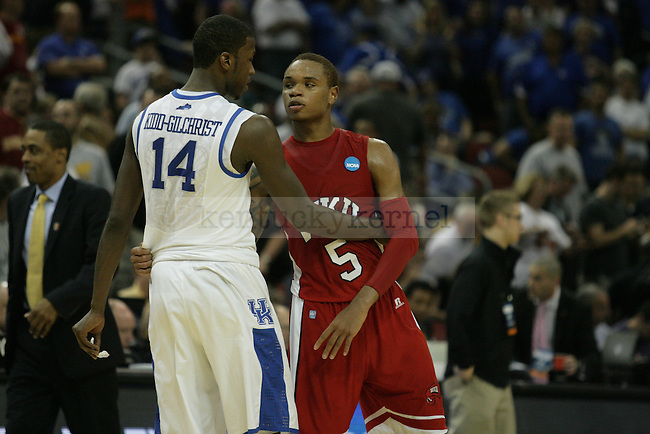 Former high school teammates Michael Kidd-Gilchrist and Derrick Gordon reunited for a moment after University of Kentucky defeated Western Kentucky University 81-66 in the second round of the NCAA Tournament, in the KFC Yum! Center, on Thursday, March 15, 2012 in Louisville, Ky.  Photo by Latara Appleby | Staff ..