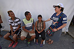 Consolata Sister Inés Arciniegas talks with Venezuelan refugees in a military-run camp at Pacaraima, a Brazilian town on the country's border with Venezuela. Arciniegas is from Colombia.