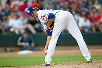 Round Rock Express pitcher Mark Hamburger #59 in the stretch during the MLB exhibition baseball game against the Texas Rangers on April 2, 2012 at the Dell Diamond in Round Rock, Texas. The Rangers out-slugged the Express 10-8. (Andrew Woolley / Four Seam Images).