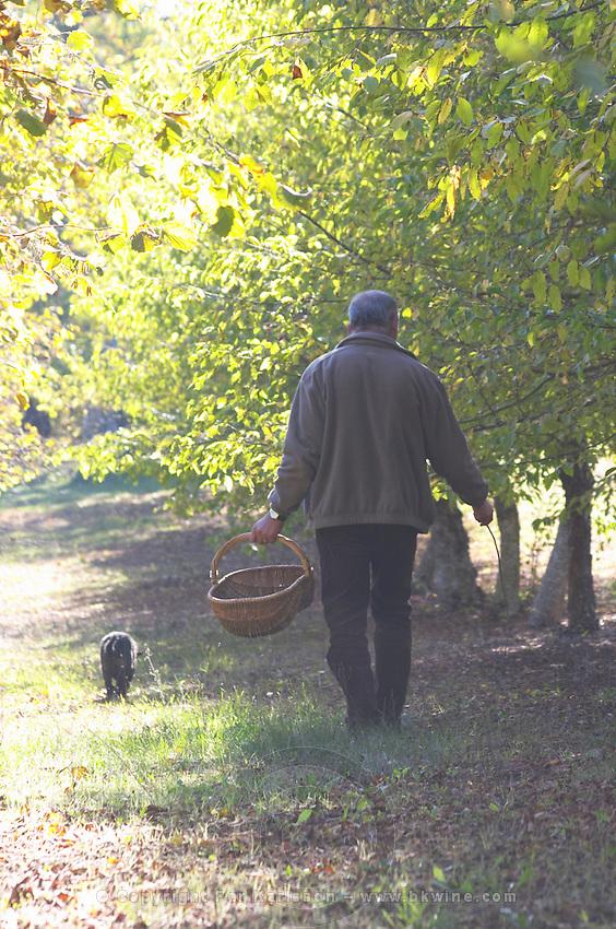 Hugues Martin, the owner of the truffles farm, with the truffles hunting sniffing dog called Mocha Truffiere de la Bergerie (Truffière) truffles farm Ste Foy de Longas Dordogne France