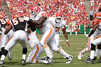 Chiefs guard Will Shields blocks Bengals linebacker Landon Johnson to open a hole for runningback Larry Johnson during the game at Arrowhead Stadium in Kansas City, Missouri on September 10, 2006. Cincinnati won 23-10.