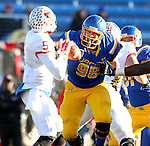 SIOUX FALLS, SD - NOVEMBER 7:  Shayne Gottlob #98 from South Dakota State University eyes quarterback Tre Roberson #5 from Illinois State in the first half Saturday in the final game at Coughlin Alumni Stadium in Brookings. (Photo by Dave Eggen/Inertia)