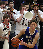 University of Detroit Jesuit fans heckle Kyle Cooper (foreground), Detroit Catholic Central, during semi-final Catholic League Championship action at Birmingham Marian Saturday, Feb. 18, 2012. Photo: Larry McKee