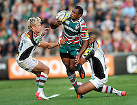 Leicester, England. Vereniki Goneva of Leicester Tigers tackled during the Aviva Premiership match between Leicester Tigers and Harlequins at Welford Road on September 22, 2012 in Leicester, England.
