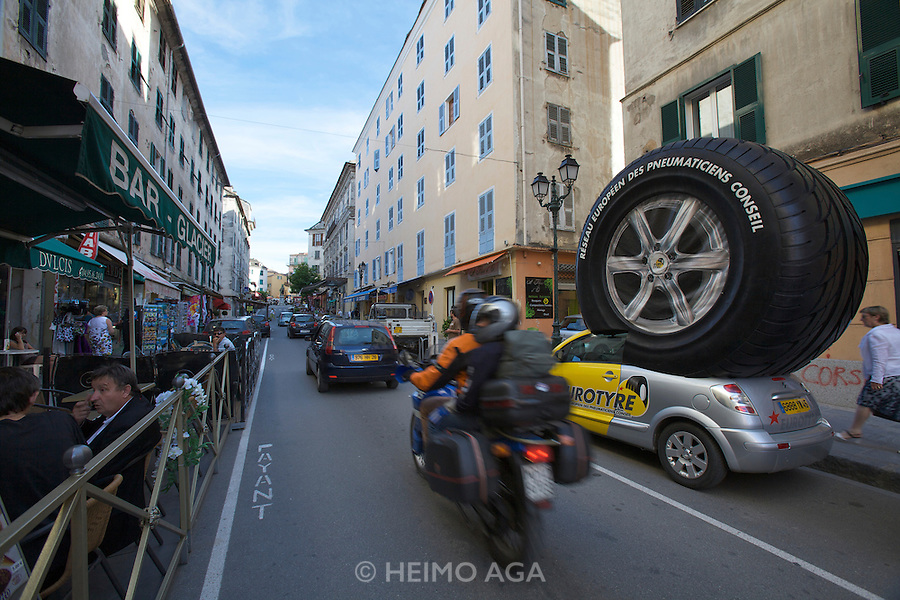 Giant tyre ad on a Citroen Pluriel at Cours Paoli, Corte's main street.