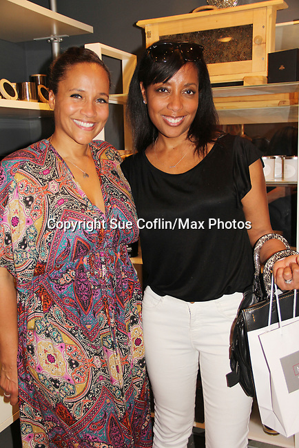 Yvonna and friend Aischa Mitchell - they both modeled together - Guiding Light's Yvonna Kopacz Wright, owner of Lomar Farms in Palisades, New York where she as a beekeeper as makes beeswax candles and other products. Tonight May 4, 2018 Yvonna presented them at NiLu - gifts - lifestyle - home in Harlem where attendees viewed them, chatted, bought them. For more information go to www.lomarfarms.com. (Photo by Sue Coflin/Max Photo)