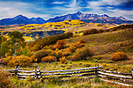 Colorado fall color with mountain and log fence
