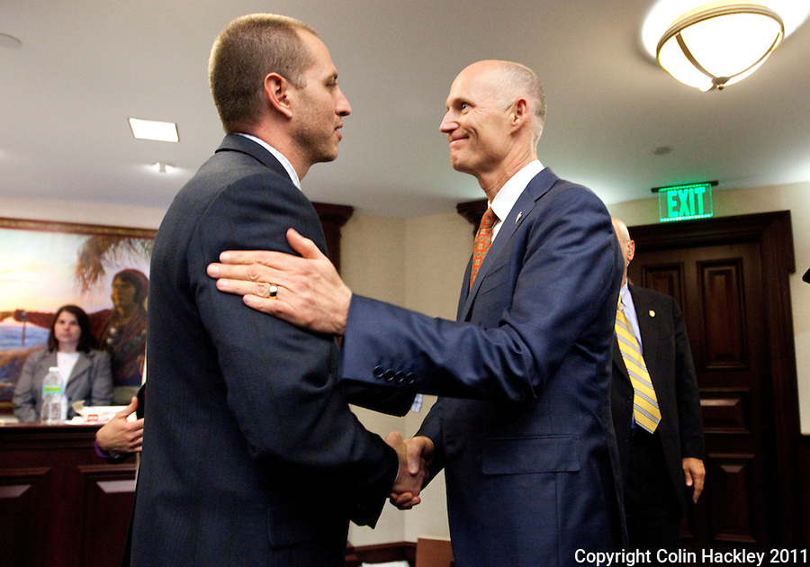 TALLAHASSEE, FLA. 5/6/11-SESSIONEND050611 CH-Rep. Rob Schenck, R-Spring Hill, left, is congratulated by Gov. Rick Scott after the passage of the pill mill bill during the last day of the regularly scheduled session, Friday at the Capitol in Tallahassee..COLIN HACKLEY PHOTO