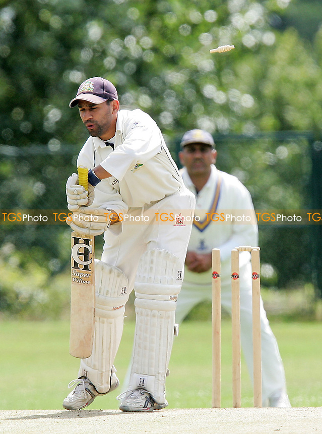 Arfan Akram of Wanstead loses his wicket to the bowling of J McNally as A Ali looks on - Wanstead CC vs Upminster CC - Evening Standard Trophy - 22/07/07 - MANDATORY CREDIT: Gavin Ellis/TGSPHOTO - SELF-BILLING APPLIES WHERE APPROPRIATE. NO UNPAID USE. TEL: 0845 094 6026..