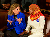 United States Representative Debbie Wasserman Schultz (Democrat of Florida), left, and US Representative Ilhan Omar (Democrat of Minnesota), right, in conversation as the 116th Congress convenes for its opening session in the US House Chamber of the US Capitol in Washington, DC on Thursday, January 3, 2019.<br /> Credit: Ron Sachs / CNP<br /> (RESTRICTION: NO New York or New Jersey Newspapers or newspapers within a 75 mile radius of New York City)