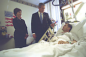 United States President George W. Bush and First Lady Laura Bush visit with Army Staff Sergeant Michael McNaughton at Walter Reed Army Medical Center Friday, January 17, 2003. Sergeant McNaughton was wounded on January 9 in Afghanistan. The first couple visited four other wounded soldiers at the hospital.<br />